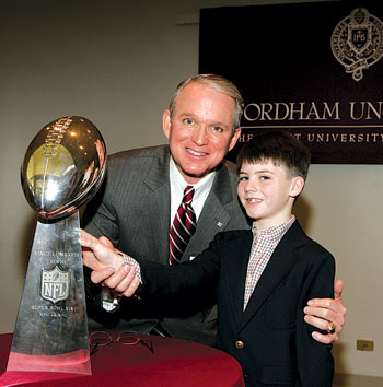 Honoree Bob Cole, GSB '78, is joined by grandson Griffin and the Lombardi Trophy.  Photo by Noren Trotman