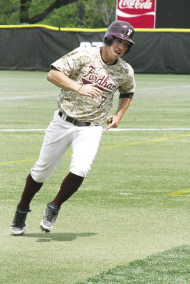 Ryan Lee, a junior at the Gabelli School of Business, and a Fordham baseball team outfielder, rounds a base while raising money for wounded veterans.  Photo by Joe DiBari