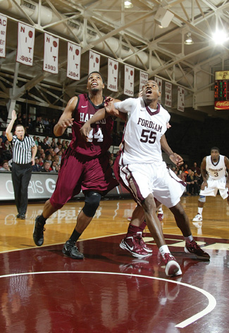 Senior Kervin Bristol boxes out a Harvard player in anticipation of a rebound.  Photo by Vincent Dusovic