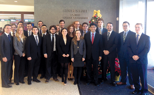 Alexis Summit, fifth from the right, front row, Muhammad Sarwar, fourth from right, and Dan DiDomenico, third from the right, managing directors of the Gabelli Student Managed Investment Fund, along with their fellow classmates. Photo by Stephen Hearn