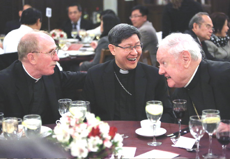 On March 28, Fordham University honored His Eminence Luis Antonio G. Cardinal Tagle, Archbishop of Manila, in a ceremony that highlighted the strong and abiding ties between the University, the New York Province of the Society of Jesus, and the Republic of the Philippines. Cardinal Tagle, center, is pictured with Edward Cardinal Egan, right, and Joseph M. McShane, S.J., president of Fordham.  Photo by Bruce Gilbert