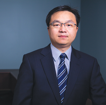 Yi Tang looks for ways to solve market problems using new data measures.  Photo by Bud Glick