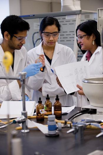 Ipsita Banerjee, Ph.D. (right), associate professor of chemistry, teaches undergraduates in the labs at Mulcahy Hall.