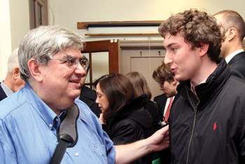 Wall Street guru Bruce Greenwald, Ph.D., (left) is guest lecturing at Fordham's Gabelli School. Here, he speaks with finance major John Mantia.  Photo by Bruce Gilbert