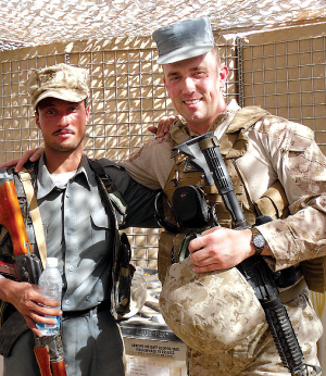 Davis (right) with an Afghan National Police Officer during a Security Shura (consultation) at the 2010 Battle of Marjeh.