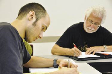 As part of Fordham's initiative for veterans, a summer Veteran's Writing Workshop runs through September, 2012 on two campuses. Here, Nelson Lowhim, left, who served in the middle east, and David Sandgrund, a Vietnam veteran, work on an in-class exercise. Photo by Janet Sassi
