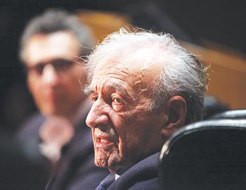 Elie Wiesel addresses the Law School's film festival, as John Turturro looks on.  Photo by Bruce Gilbert