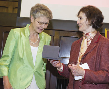 Jocelyn Wogan-Browne, Ph.D. (left), receives a medal signifying her chair from benefactor Theresa Mullarkey.  Photo by Chris Taggart