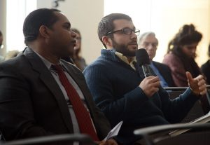A student asks the panelists a question. To his left is a representative from the Cuba Mission to the United Nations, who attended the Feb. 26 panel. Photo by Joanna Mercuri