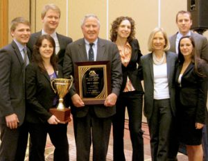 John Feerick (LAW '61), former dean of Fordham Law, poses with the national-champion mediation team of Fordham's Dispute Resolution Society.