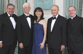 "From left to right: John Tognino, FCLS '75, chairman of Fordham's Board of Trustees; honorees Mario J. Gabelli, CBA '65; Regina M. Pitaro, FCRH '76; Maurice J. ""Mo"" Cunniffe, FCRH '54; and Joseph M. McShane, S.J., president of Fordham  Photo by Jon Roemer"