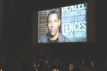 Denzel Washington, FCLC '77, welcomes attendees at the 2010 Founder's Award Dinner via video.  Photo by Jon Roemer