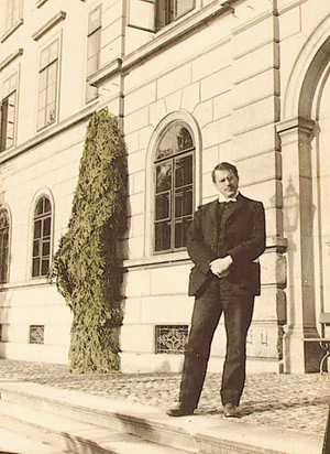 Carl Gustav Jung is pictured standing in front of a building in Burghölzi, Zurich, Switzerland.