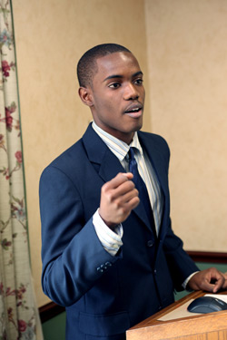 In accepting the Peter Owens Jr. Scholarship, Fordham freshman David Marcelin speaks about Haitians' need for education, now more than ever, in the wake of this year's earthquake. Photo by Bruce Gilbert