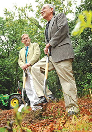 John Wehr, Ph.D. (left), director of the Calder Center, breaks ground on July 14 with Stephen Freedman, Ph.D., provost of the University (right). Photo by Bruce Gilbert