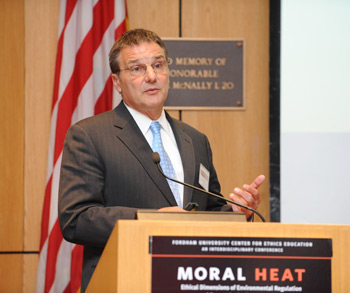 John Filippelli tells the audience that climate change directly affects all of the EPA's other initiatives. Photo by Chris Taggart