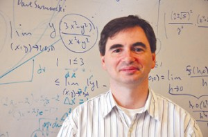 Cris Poor, Ph.D., says mathematicians provide ideas that people can use to understand the world. Photo by Janet Sassi
