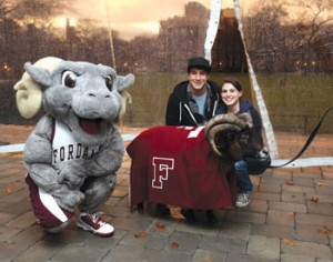 "Top: ""Buster"" from the Dawn Animal Agency surveys his approving public.  Above: Students pose with ""Buster"" and Fordham's costumed mascot. Photos by Bruce Gilbert"