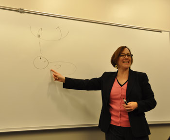Lisa Cataldo, Ph.D., explains to the audience that spiritual development begins in infancy. Photo by Janet Sassi