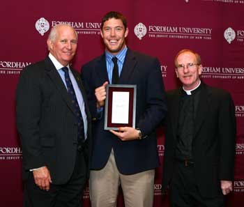 John Skelton (center) was selected in the fifth round of the NFL Draft by the Arizona Cardinals. Photo courtesy of Fordham Athletics
