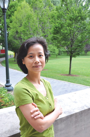 """Xiaolan """"Ellen"""" Zhang, Ph.D., studies mobile computer networks that are held together thanks to buses, motorcycles and even oxcarts. Photo by Gina Vergel"""