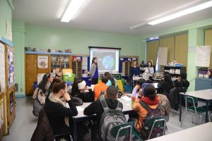 Fordham Law students Sara Gates, Elena Rizzo and Noelle Park with students from P.S. 191