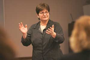 Kathleen P. King, Ed.D., explains how she successfully integrates new technologies into her teaching.  Photo by Bruce Gilbert