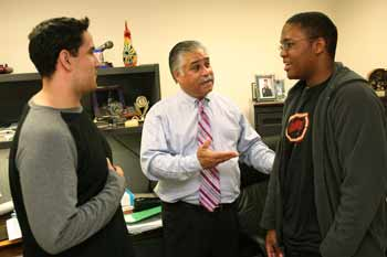 David Irizarry (FCRH '04), a medical student at the University of Buffalo and former CSTEP student at Fordham, chats with director Michael Molina, center, and freshman Mitch Turner, right. Turner is a CSTEP student studying pre-med biology at Fordham College at Rose Hill. Photo by Michael Dames