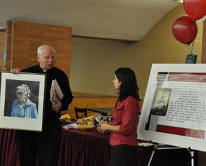 Joseph Currie, S.J., presenting Sandra Lobo Jost (FCRH '97) with a portrait of Dorothy Day. Photo by Patrick Verel
