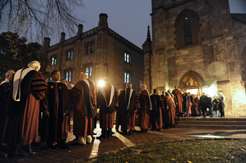 Faculty, trustees and other guests wait outside the University Church for the procession to begin. Photo by Chris Taggart