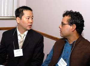 "Vijay Prashad, Ph.D., (right) speaks with James Kim, Ph.D., who is teaching the summer course, ""Current Issues in Asian-American Studies.""  Photo by Ken Levinson"