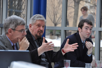 from left to right: Paul McNelis, S.J., Milan Zeleny, Ph.D., and Robert Hume, Ph.D., discuss the organic nature of governmental, corporate and financial systems.  Photo by Nina Romeo