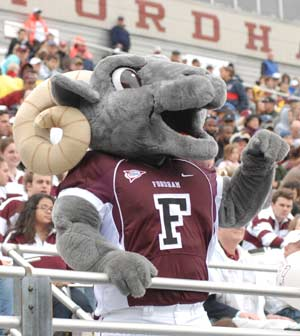 The new Fordham Ram leads the crowd in cheering the football team.  Photo by Chris Taggart
