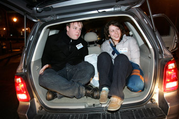 Members of the Fordham community pack themselves into a van to canvass neighborhoods in the Bronx for the annual HOPE count.  Photo by Bruce Gilbert