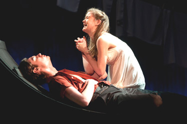 In a scene from Maria Irene Fornes' play Sarita, the lead character (Rebecca Ballenger) grieves over the body of Julio (Thomas Pecinka), whom she has just stabbed to death after a confrontation. Though done in self-defense, the act drives her to madness.  Photo by Leo Sorel