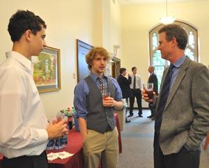 (l to r) CBA freshman Christopher Tretrola and FCRH freshman Tim Luecke speak with Bernard J. Barry, S.J., assistant dean of CBA.  Photo by Patrick Verel
