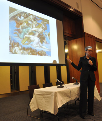 Lee Palmer Wandel, Ph.D., professor of history and religious studies at the University of Wisconsin-Madison, with a detail from Michelangelo's 'Last Judgment.' Photo by Patrick Verel
