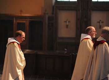 Joseph M. McShane, S.J., president of Fordham, follows the recessional out of the University Church.