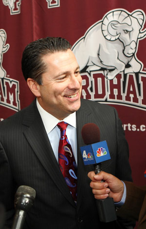 Tom Pecora answers questions from the media at a news conference announcing his new post as head men's basketball coach. Photo courtesy of Fordham Athletics