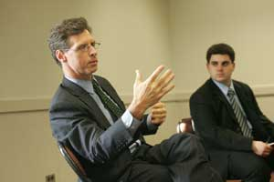 Joseph P. Quinlan (left) speaks to the College of Business Administration Finance Society. Photo by Bruce Gilbert