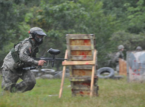 An ROTC cadet runs to a secure position while another cadet lays down cover fire. Photo by Joseph McLaughlin