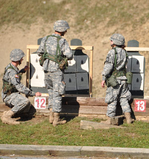 Cadets check their marksmanship on the firing range at Camp Smith. Photo by Joseph McLaughlin
