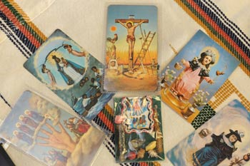 Several holy cards used in the practice of Afro-Latin  religions are part of the collection donated to Fordham by Maureen A. Tilley, Ph.D.  Photo by Chris Taggart