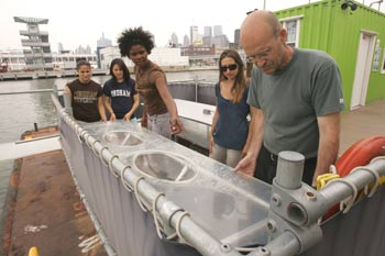 Left to right, students Elyse Santoro, Krystina Holak, Jeana Fletcher and Lydia Orsi with Colin Cathcart at work on the Science Barge.  Photo by Bruce Gilbert