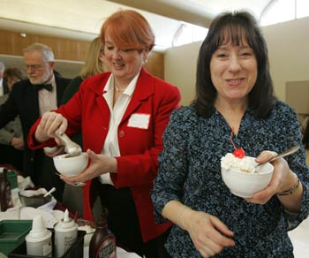 Jean Walsh, senior executive secretary at the William D. Walsh Family Library, gets ready to dig into a bowl of ice cream at the Winter Wonderland luncheon. Photo by Bruce Gilbert