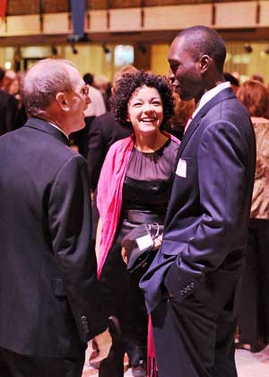 Joseph M. McShane, S.J., president of Fordham, chats with alumni Rachel Foster (FCLC '06) and Carl Louis (FCLC '06). Photo by Chris Taggart