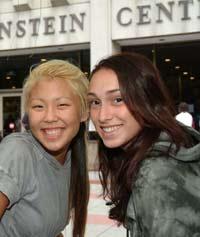 Fordham College at Lincoln Center freshmen Amy Ko (left) and Natasha Keynejad on the plaza at orientation. Photo by Chris Taggart