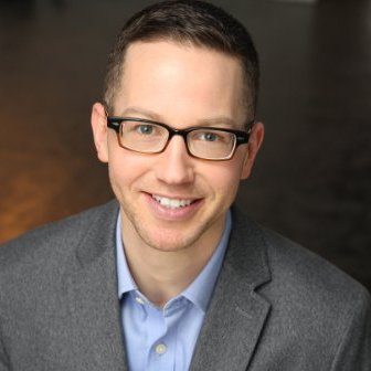 Travis Russ, PhD, an associate professor of communications and media management and the artistic director of Life Jacket Theatre Company