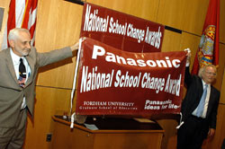 Lew Smith, Ph.D., associate dean for program development and outreach at the Fordham Graduate School of Education, (left) and James Hennessy, Ph.D., dean of GSE, announce Panasonic Corp.'s sponsorship of the National School Change Awards.  Photo by Ken Levinson