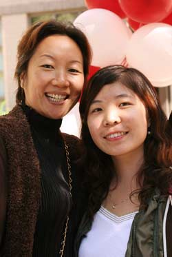 FCLS freshman Meng Zhang (right) and her mother Feng Jih may have traveled the furthest. They are from Beijing.  Photo by Bruce Gilbert